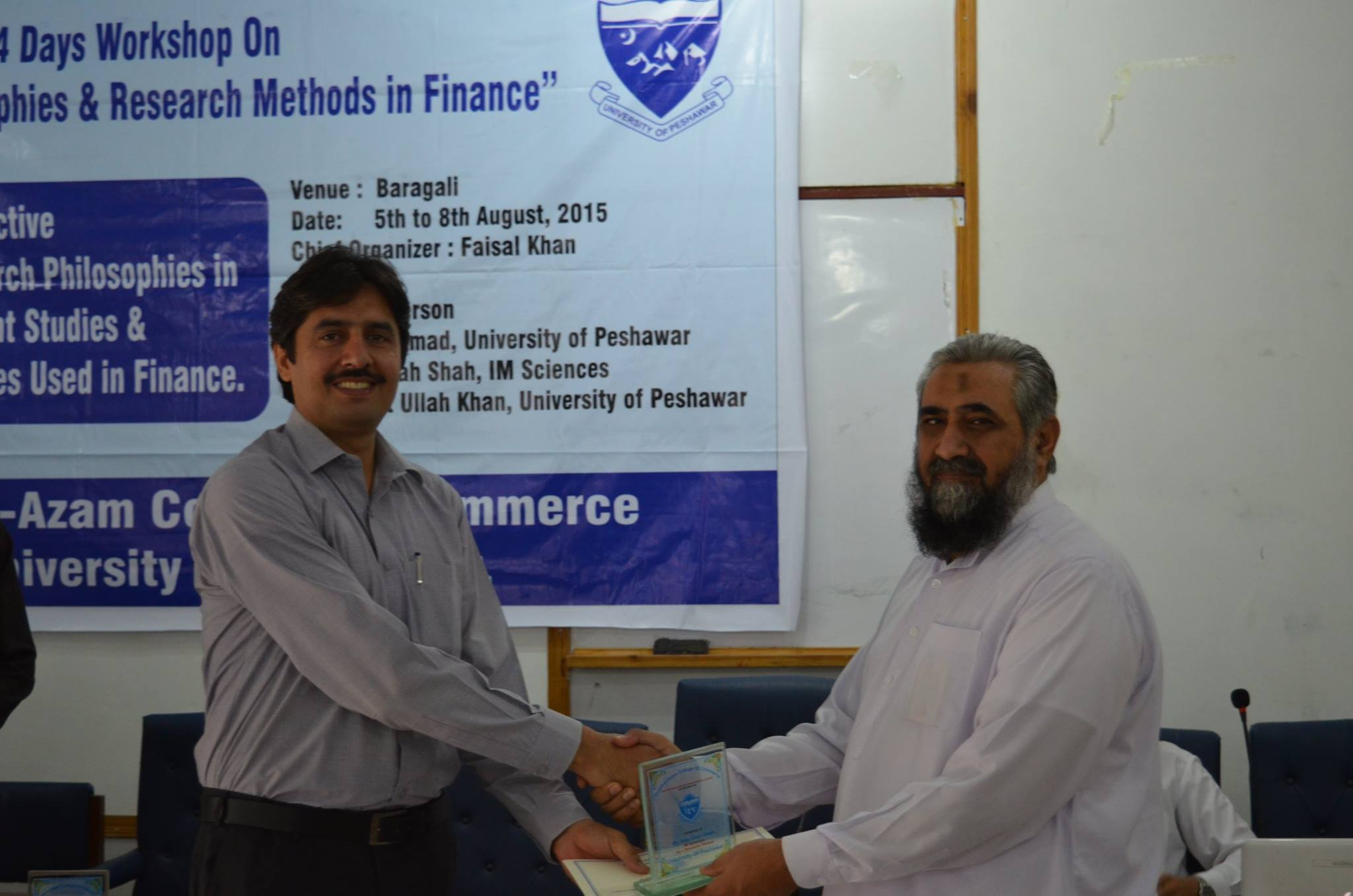 Dr. Atta Ullah Shah, Assistant Professor,  IMS receiving certificate from Syed Muhammad Abbas
