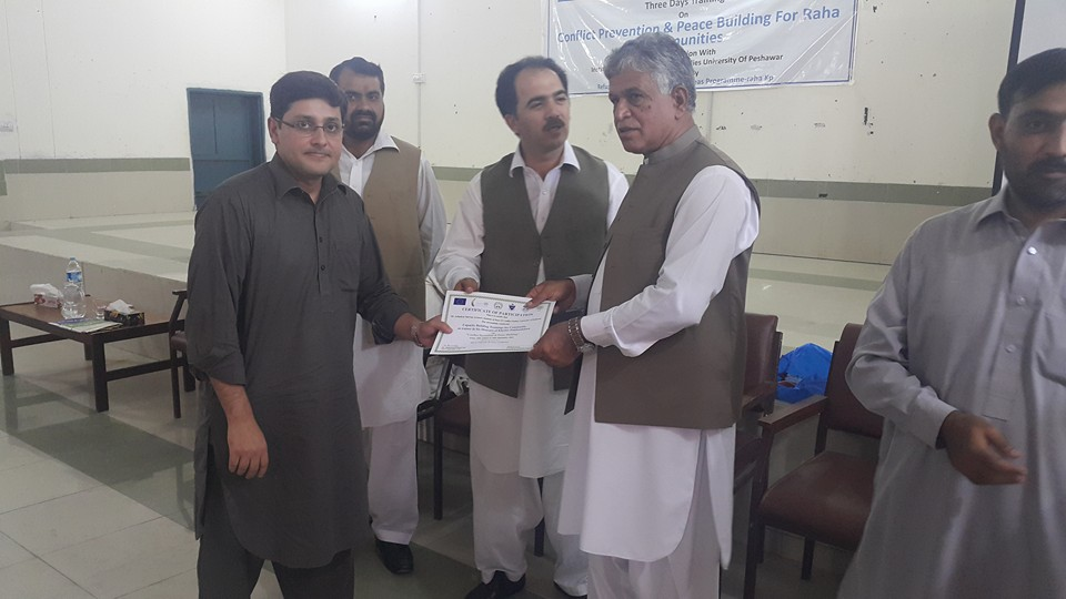 Mr. Asfandyar Marwat lecturer IPCS receiving certificate from VC Abdul Wali Khan University Mardan Prof. Dr. Ihsan Ali (SI) at Buner Campus AWKUM