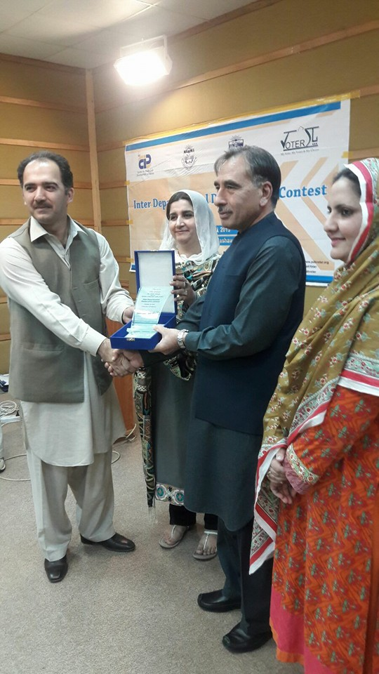 Dr. Jamil Director IPCS receiving shield from Vice Chancellor, Uop