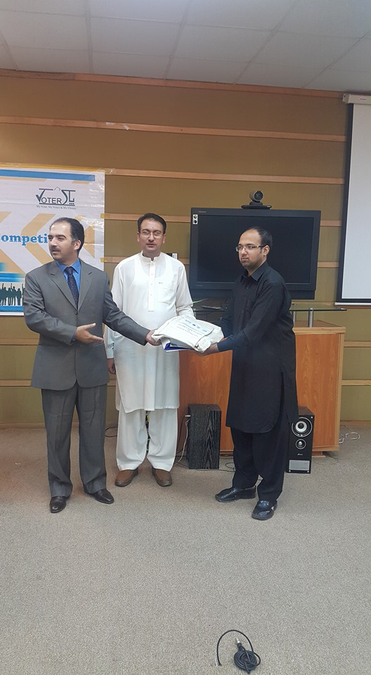 Mr. Jawad Aziz receiving his first award in quiz contest