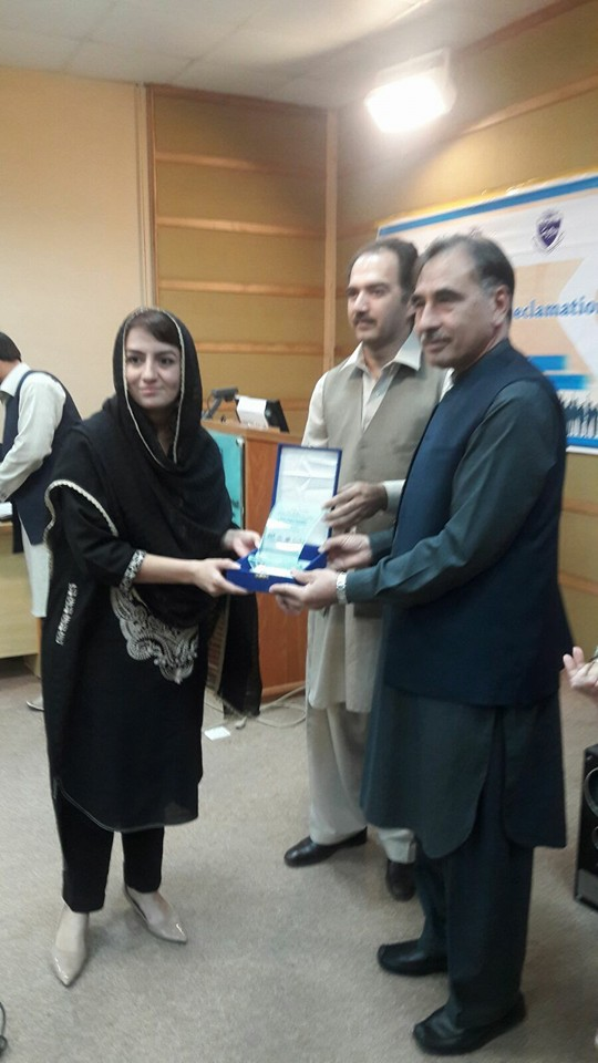 Ms. Rabia Fayyaz receiving her shield by Vice Chancellor UoP