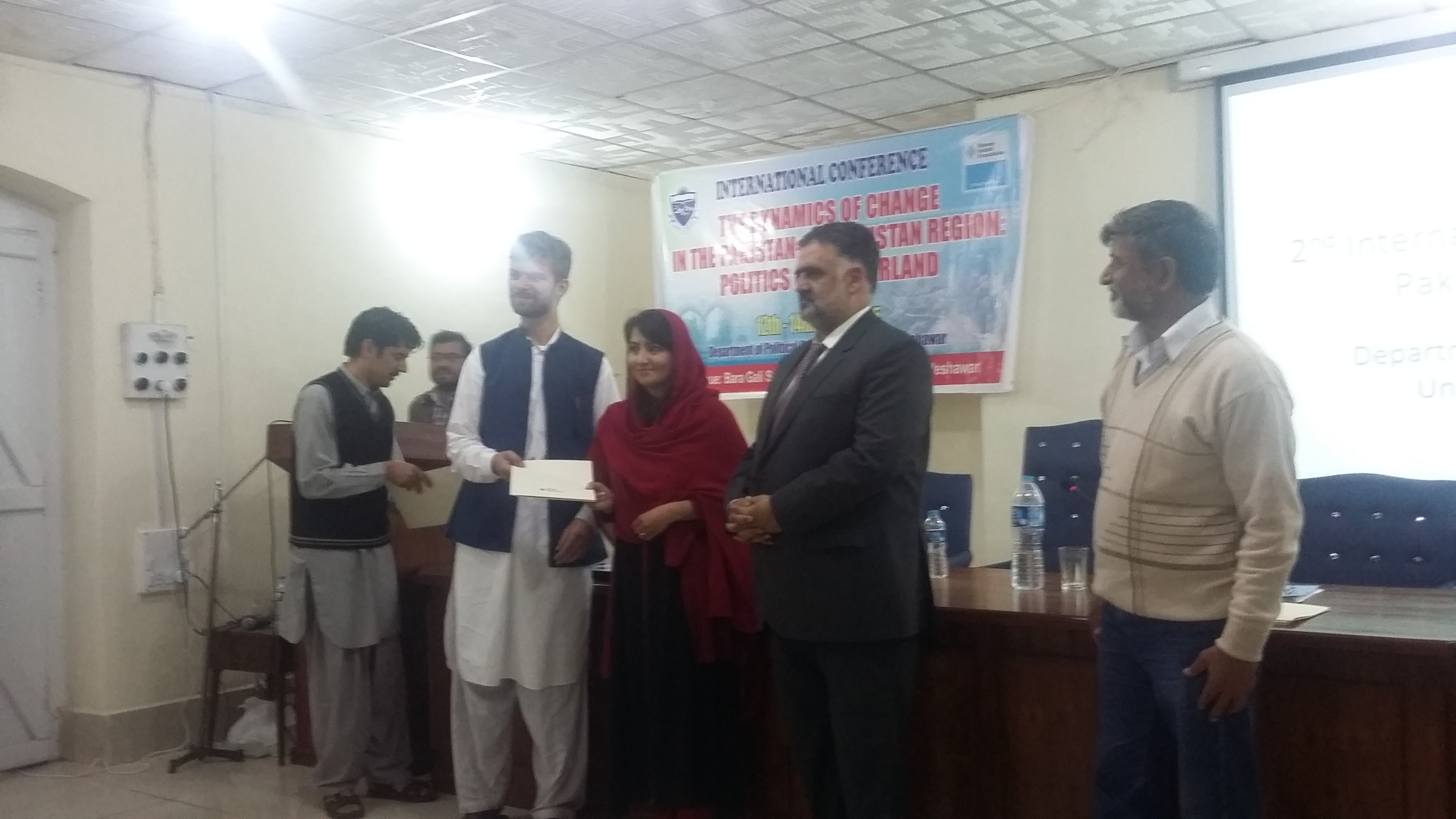 Ms. Rabia Fayyaz receiving here certificate