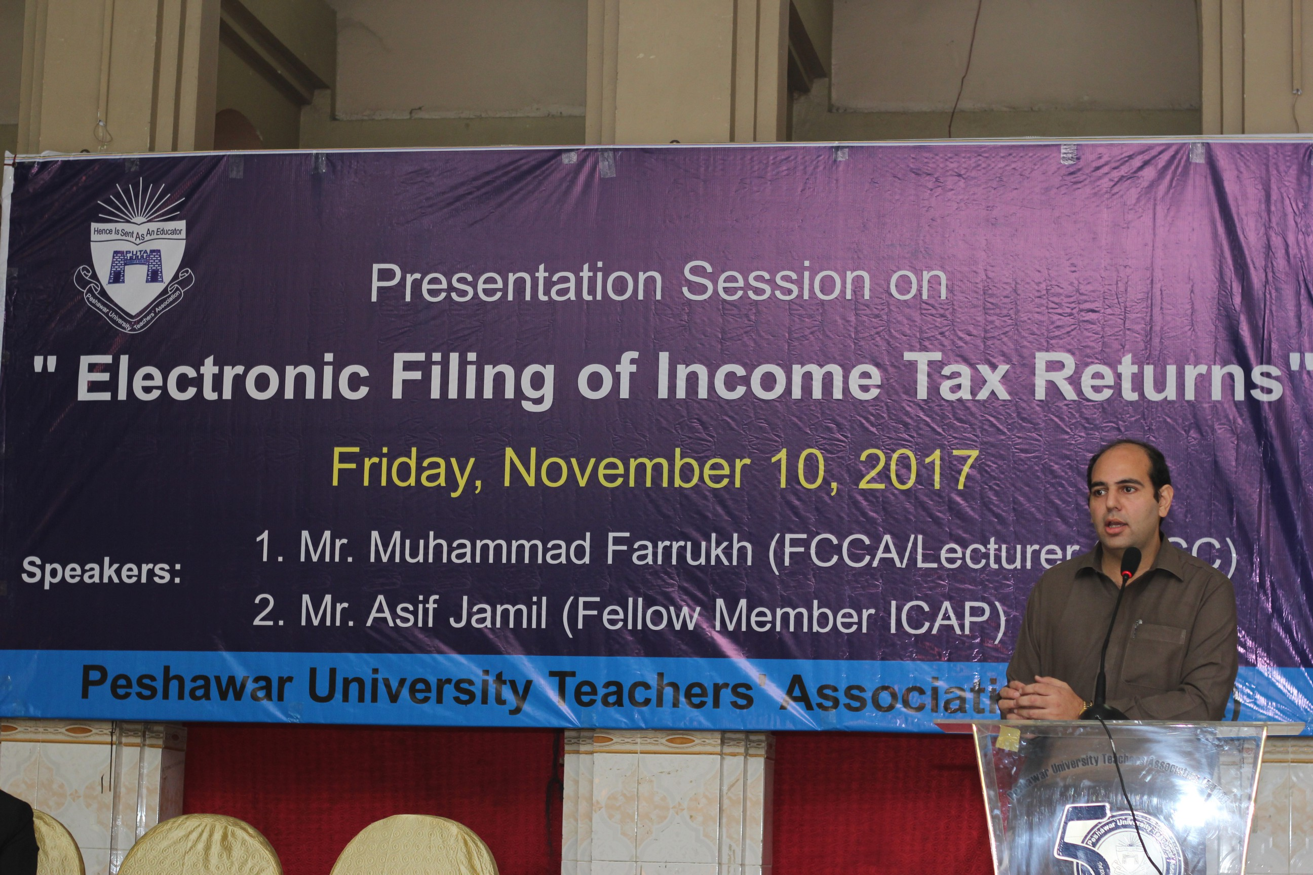 Mr. Muhammad Farrukh, Lecturer, QACC, University of Peshawar briefing participants on e-filing