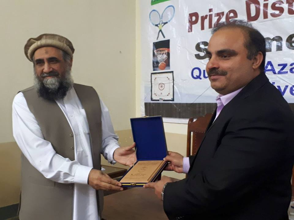 Professor Syed Muhammad Abbas presenting shield to Mr. Gulzar Khan, Deputy Director, SBP