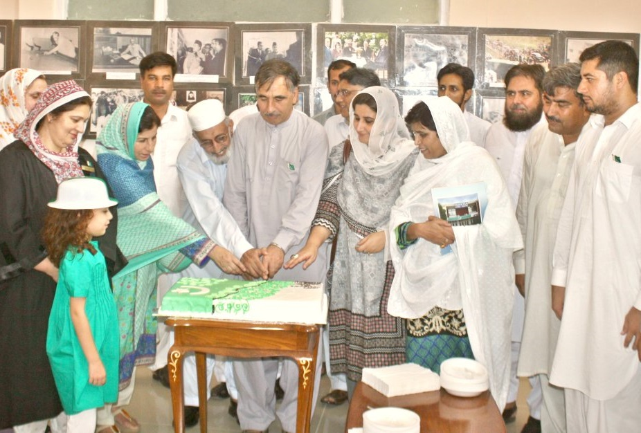 Vice Chancellor UoP Prof. Dr. Muhammad Rasul Jan cutting the 69th independence day cake at the University of Peshawar