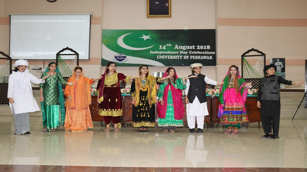 Students of University Model School are presenting a tableau show  at the 'Independence Day celebrations'  at the Convocation Hall ,University of Peshawar
