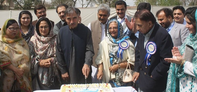 Vice Chancellor UoP Prof. Dr. Muhammad Rasul Jan cutting cake during the alumni reunion of the Department of Social Work University of Peshawar