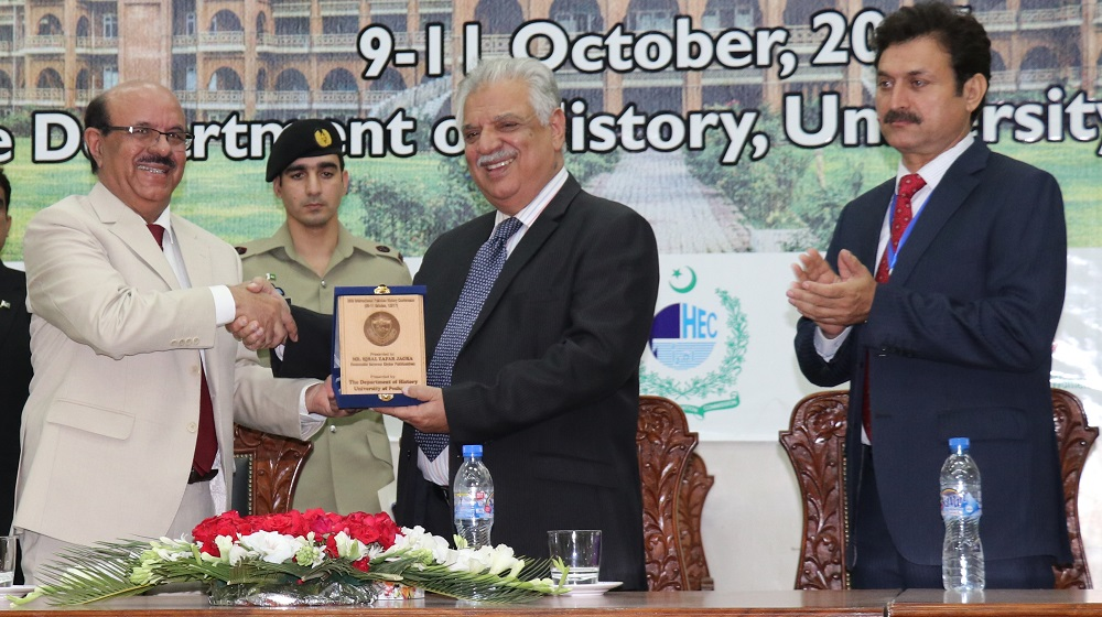 Honourable Vice Chancellor University of Peshawar,  Prof. Dr. Muhammad Asif Khan presenting shield to Governor KP Engr. Iqbal Zafar Jhagra at the  Inaugural Session of the 26th International Pakistan History Conference organised by the Department of  History, University of Peshawar