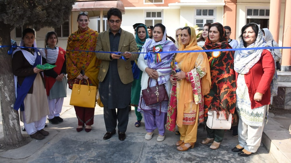 Kamran Khan Bangash  special assistant to chief minster on I.T is cutting a blue ribbon to inaugurate Mega Science exhibition at College of Home Economics. Around 13 female degree colleges participated in the event showcasing 130 science models.