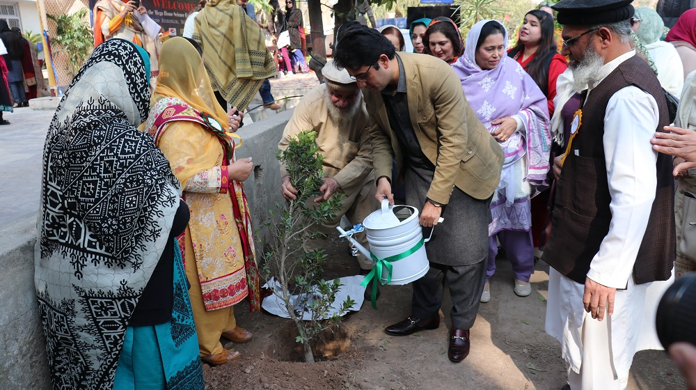 Special assistant to Chief Minister on Information technology Kamran Khan Bangash is watering while planting a tree as a part of clean and green Pakistan movement at College of Home Economics facade on 24th Janaury, 2019  at mega science event.