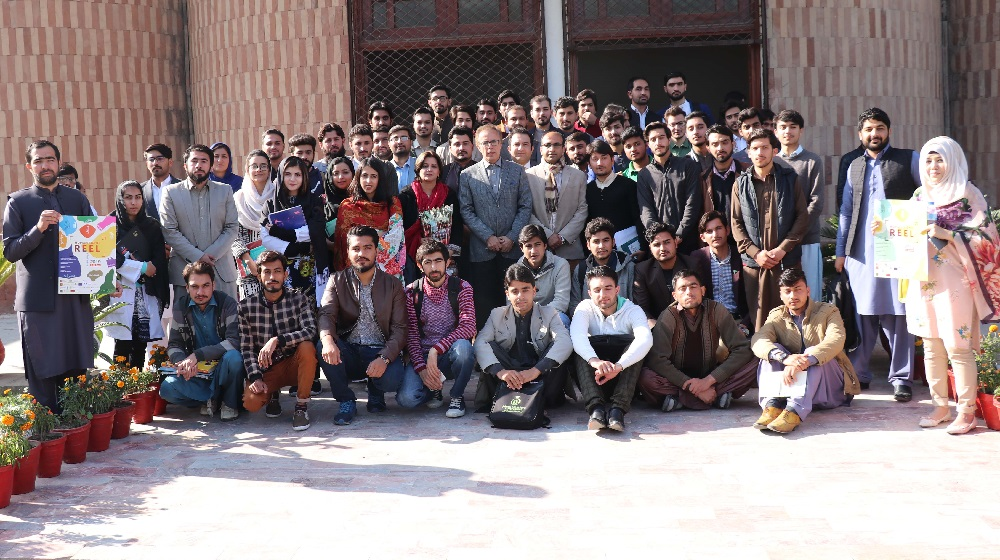 Moderators, speakers and students posing for a group photo at the eve of annual EU-UN film festival screened at Sir Sahibzada Abdul Qayyum conference Hall,University of Peshawar on 2nd December, 2019.