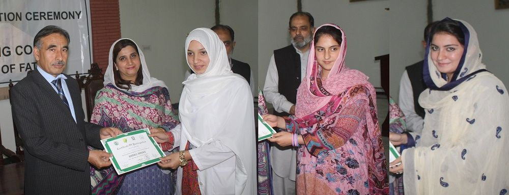 Vice Chancellor UoP Prof. Dr. Muhammad Rasul Jan distributing certificates among participants of marble mosaic training at the University of Peshawar