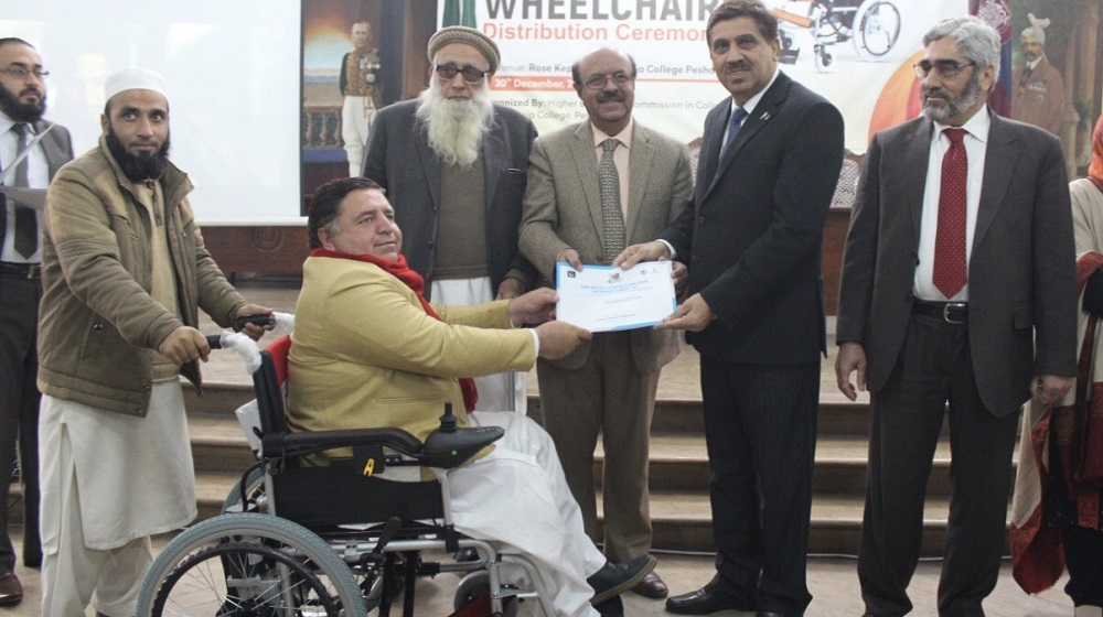 Vice Chancellor University of Peshawar Prof.,Dr.Muhammad Asif Khan along with all public sector vice chanecllors' are distributing electric wheelchairs under Prime Minister inititive at Islamia College Unievrsity on 31st December, 2019.