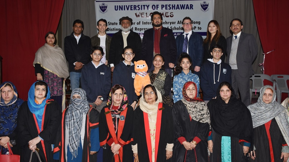 Minister of State for Interior Shehryar Khan Afridi is posing along Scholars cup representative and faculty of University of Peshawar at Agha Khan auditorium on 22nd January, 2019