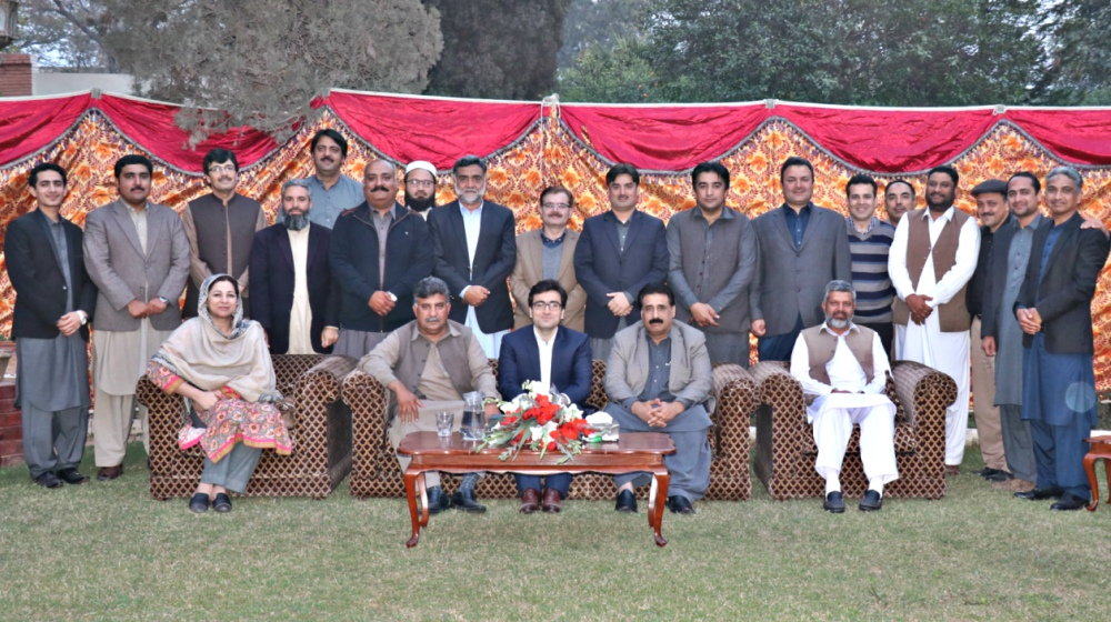 Registrar University of Peshawar Dr. Zahid Gul  posing with administrative officers at the farewell dinner for outgoing Assistant Registrar Academics Mr. Farhan Khan