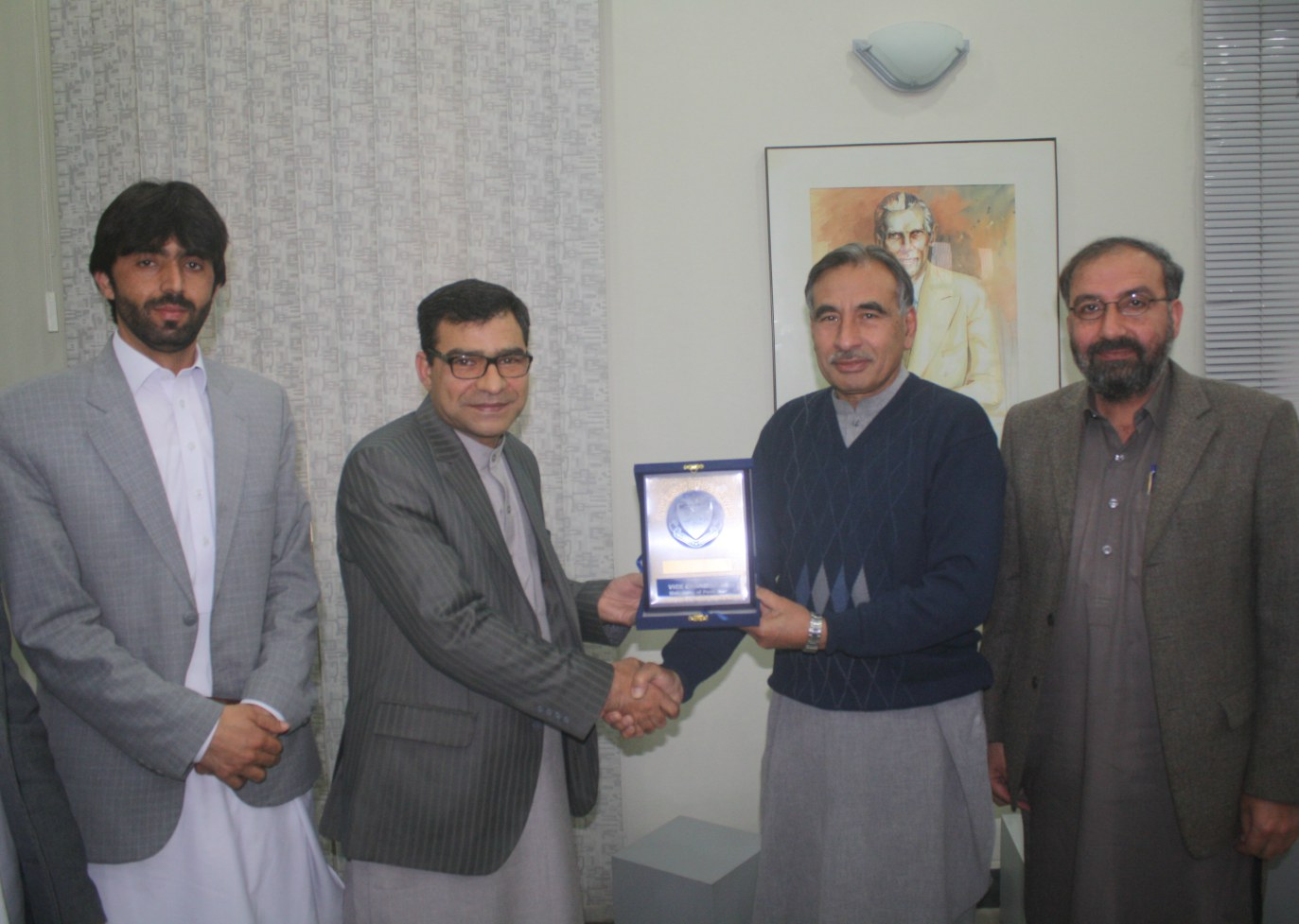 Vice Chancellor UoP Prof. Dr. Muhammad Rasul Jan presenting University shield to Dr. Abdullah Waheed Poyan, the Consul General of the Republic of Afghanistan to Peshawar,Pakistan