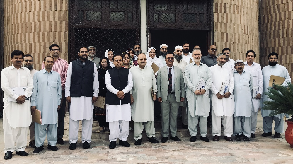 The Vice Chancellor University of Peshawar Prof. Dr. Muhammad Asif Khan  pose for a group photo after the first general orientation session about Community Service Programs at SSAQ hall with the departmental heads on 25th September, 2018.