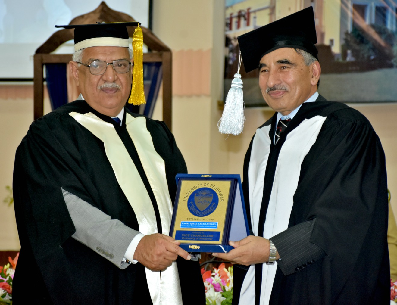 Vice Chancellor UoP Prof. Dr. Muhammad Rasul Jan presenting shield to Governor KP Iqbal Zafar Jhagra at the University of Peshawar Convocation 2016