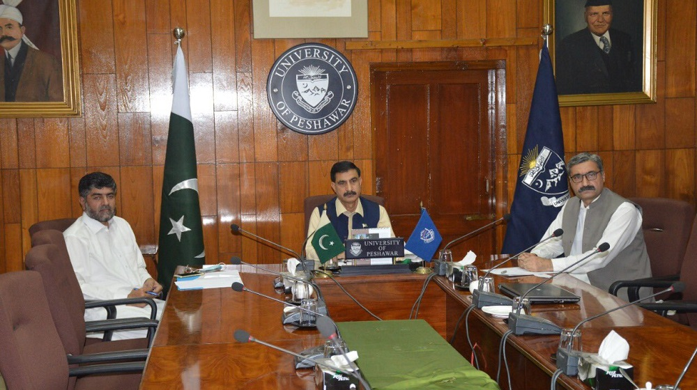Vice Chancellor Prof. Dr. Muhammad Idrees chairing a virtual meeting of HoDs while accompanied by Mr. Saifullah Khan Registrar, UoP and Prof. Dr. Atta Ur Rehman Chairman Department of Geography.