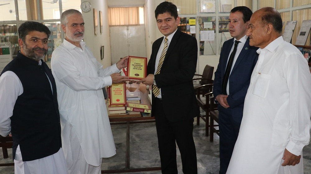 Vice Chancellor, Prof. Dr. Muhammad Abid receives Uzbek dictionary and Uzbek books of the Uzbek Poet Alisher Navoi from Lt. Col. Sadulla Tashmatov