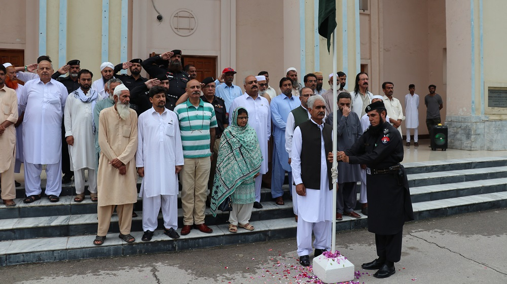 Pro-Vice Chancellor Prof. Dr. Johar Ali is elevating the national flag on the occasion of Independence Day at University of Peshawar's facade of the convocation hall.