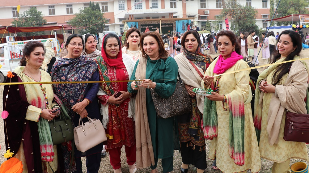 Chief Guest Maliha Ali Asghar Khan and guest of honour Prof.Tazeem Khan along with Principal College of Home Economics is cutting the blue ribbon at the eve of one day 'Cultural Gala' at the college on 4th February, 2020.