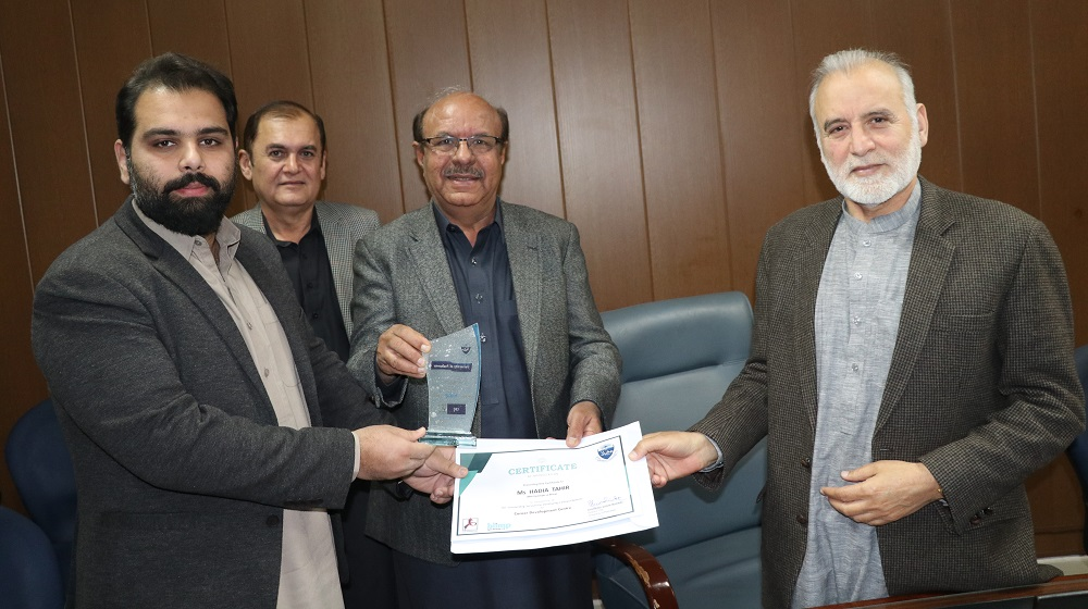 Vice Chancellor University of Peshawar Prof.Dr.Muhammad Asif Khan is giving certificate to Blimp representative Faaiz Ahmad for launching CDC link at the University of Peshawar website for Alumni build-up and career advancements on 14th February 2020.