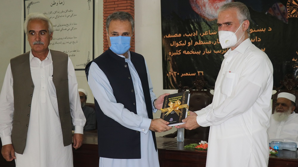 Vice Chancellor, University of Peshawar, Prof. Dr. Muhammad Abid presents book to Chief Secretary Khyber Pakhtunkhwa Dr. Kazim Niaz at the 5th anniversary of Prof. Dr. Jehanzeb Niaz at Pashto Academy, University of Peshawar.