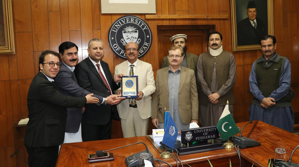 Vice Chancellor University of Peshawar Prof.Dr.Muhammad Asif khan is honouring Ranra University Kabul representatives for promoting initiatives for mutual academic exchange programs on 18th February, 2020.