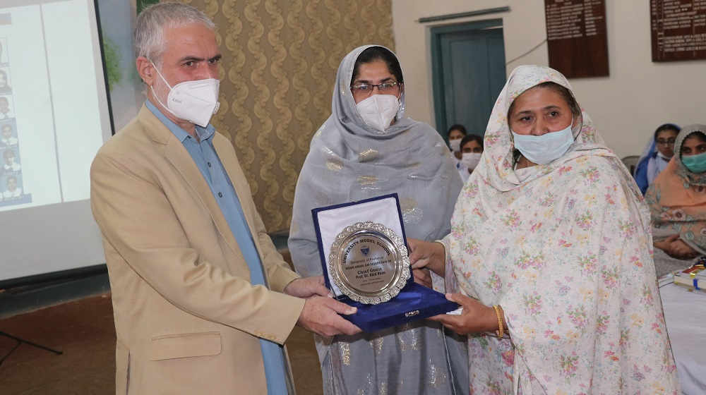 Pro-Vice Chancellor, University of Peshawar Prof. Dr. Muhammad Abid receives a souvenir from Prncipal University Model School, Ms. Nighat Khatak during  64th Annual Prize Distribution at University Model School, Peshawar