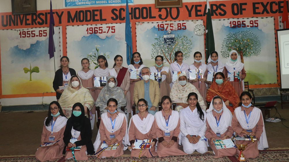 Position holder students of University Model School pose for a photo with Pro-Vice Chancellor and Teaching staff at 64th Annual Prize Distribution at University Model School, Peshawar