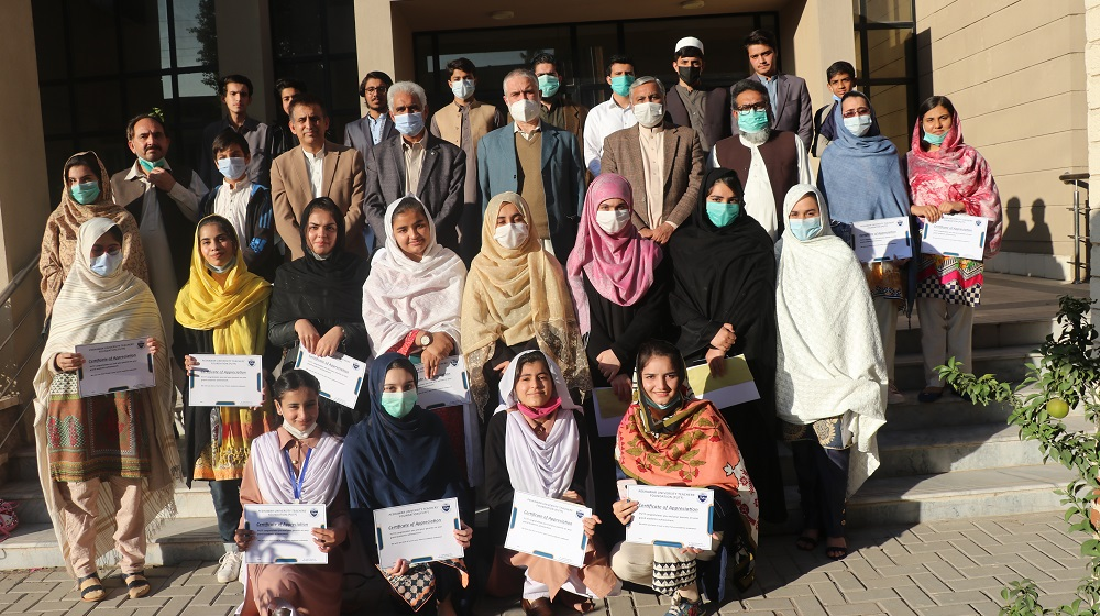 SSC/ FA/ FSc/ A-Level/ O-Lvel position holder employee's children pose for a group photograph with Pro-Vice Chancellor, University of Peshawar, Prof Dr Muhammad Abid at the prize distribution ceremony organised by the Peshawar University Teachers Foundation (PUTF).