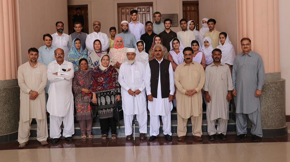 Pro-Vice Chancellor Prof.Dr. Johar Ali is posing for a group photo with the awardees of cash prizes and certificates for outstanding matriculation scores   under the auspices of the Peshawar University Teachers Foundation on 27th August, 2019.