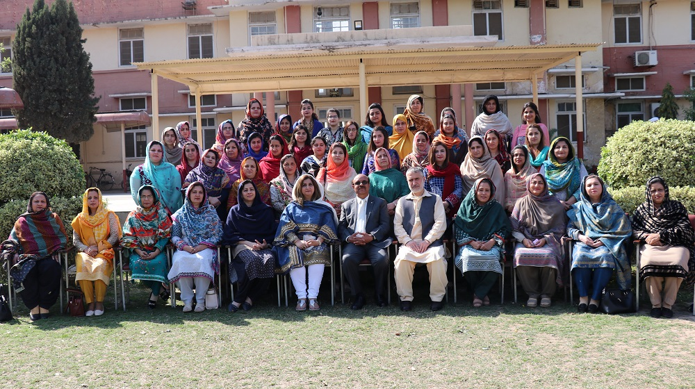 The Vice Chancellor University of Peshawar, Prof. Dr. Muhammad Asif Khan posing for a group photo with faculty of College of Home Economics on monday, 5th of March