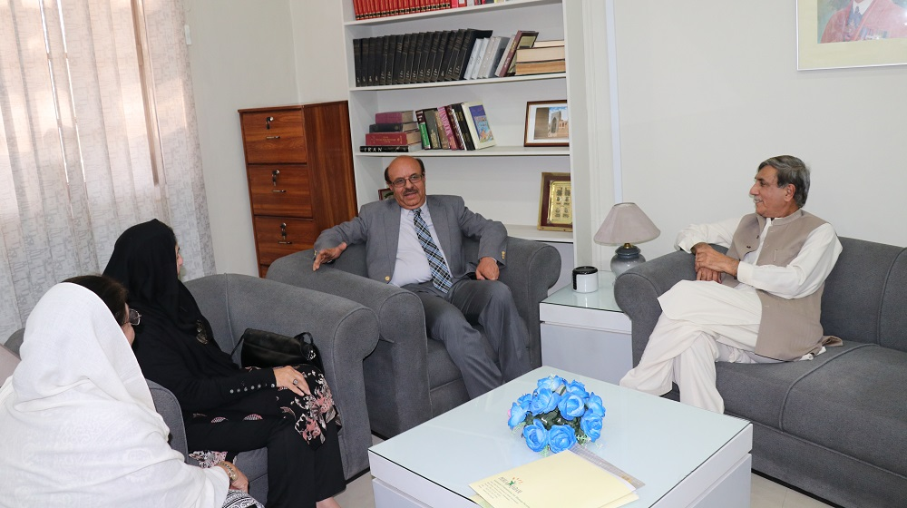 Vice Chancellor University of Peshawar, Prof. Dr. Muhammad Asif Khan along with Farida Nishtar, Ammal Opel and Prof. Fazal ur Rahman Sethi  consulting on reviving community and social services plans at the University of Peshawar