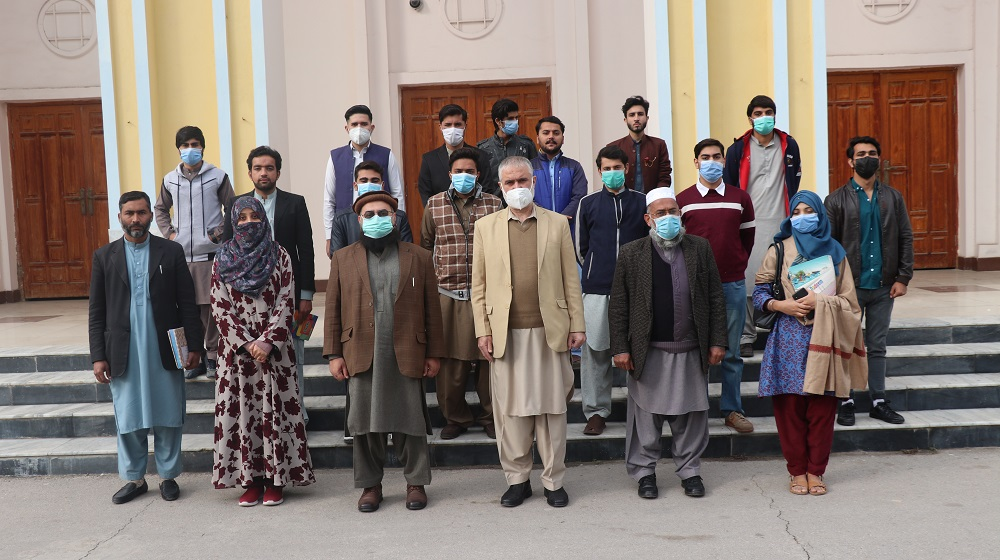 Prof. Dr. Muhammad Abid, Pro-Vice Chancellor University of Peshawar, in a group photo with students of Qauid e Azam Commerce College after awarding  scholarship under the Prime Minister's Pakistan Ehsaas Scholarships Program.