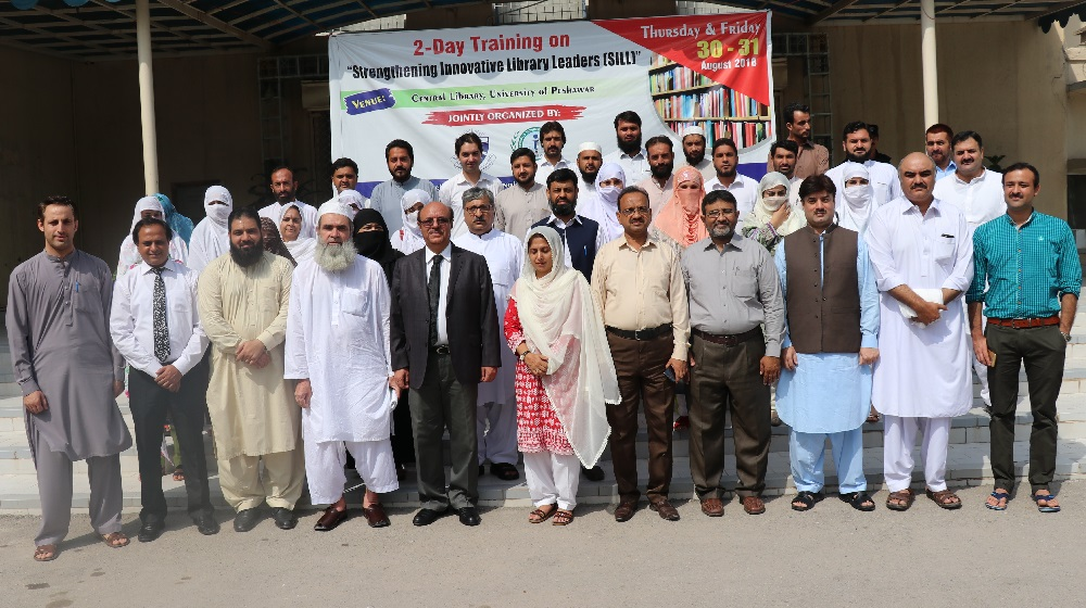 The participants of the two day  Workshop  meant for equipping librarians with the latest digital tools stand with the Vice Chancellor University of Peshawar Prof. Dr. Muhammad Asif Khan at the inaugural session at the Central Library facade.