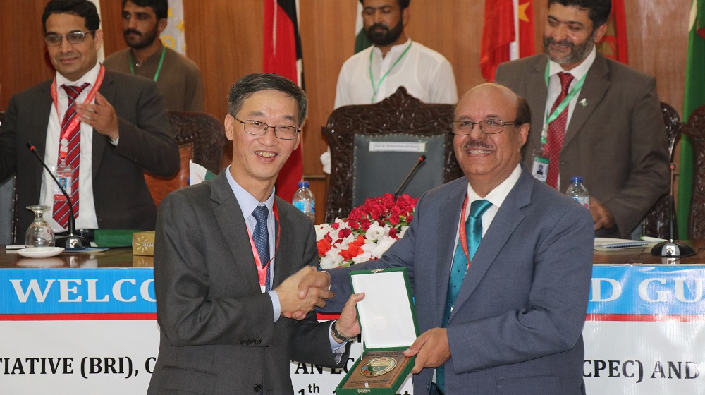 The Vice Chancellor University of Peshawar Prof. Dr. Muhammad Asif Khan is presenting souvenir to chief guest; his excellency, Chinese ambassador to Pakistan Mr. Yao Jing in CPEC, BRI and TRI International Confernce (11-13 September, 2019) at University of Peshawar.