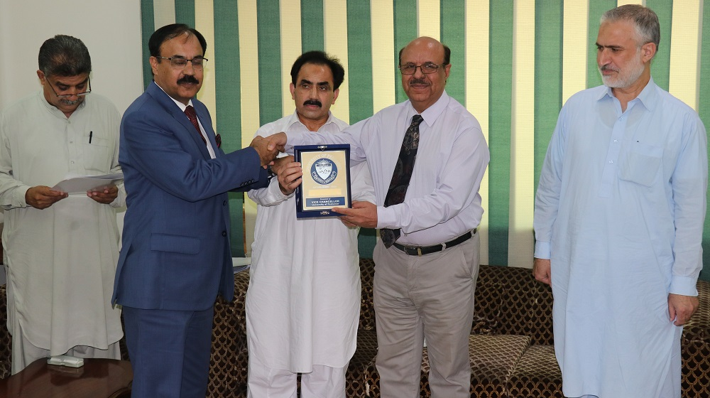 The Vice Chancellor University of Peshawar Prof. Dr. Muhammad Asif Khan is honouring Principal Army Burn Hall College for Girls  for showing quality results in B.A/ B.Sc annual examinations 2018 of University of Peshawar on 27th September.