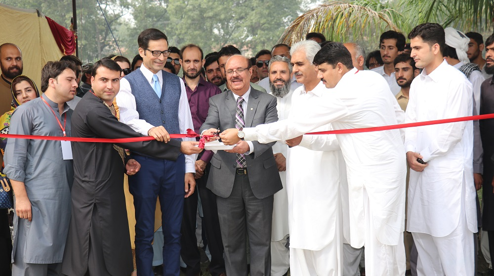 The Vice Chancellor, University of Peshawar Prof. Dr. Muhamamd Asif Khan is cutting a ribbon to inaugurate the grand 'Peace Fair' Organized by the International Relations Students Association( IRSA) in sponsorship with FAW motors.