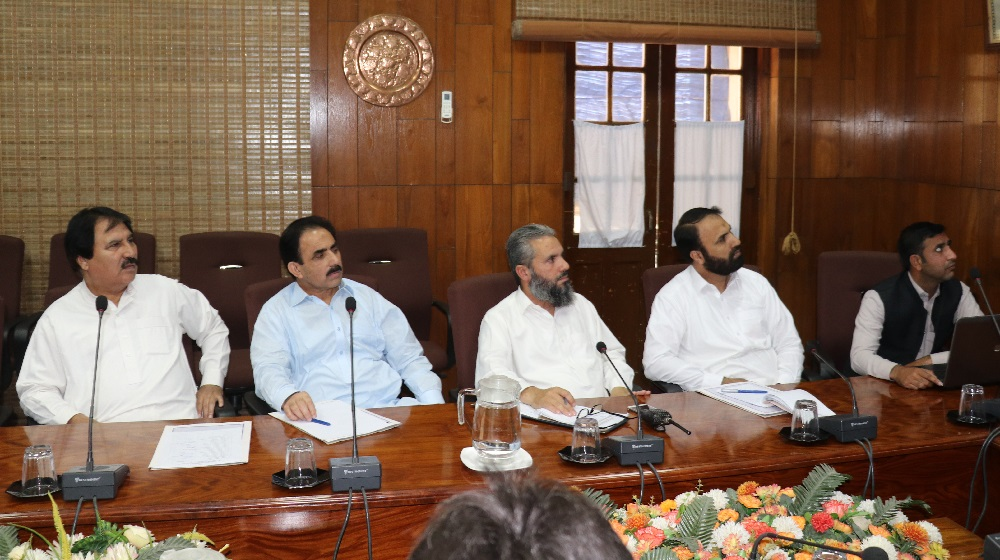 The sectional heads of the University of Peshawar are listening to a presentation from the treasurer on 09 October, 2018 in a weekly meeting.