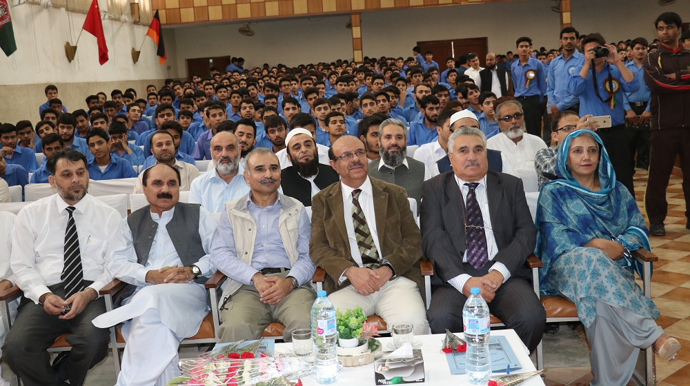 The Vice Chancellor University of Peshawar Prof. Dr. Muhammad Asif khan is sitting along the UPS first batch student Mr. Kalim Ullah and Principal UPS Ms. Zahida Kulsoom to witness the function at honour BISE toppers from the School on Tuesday.