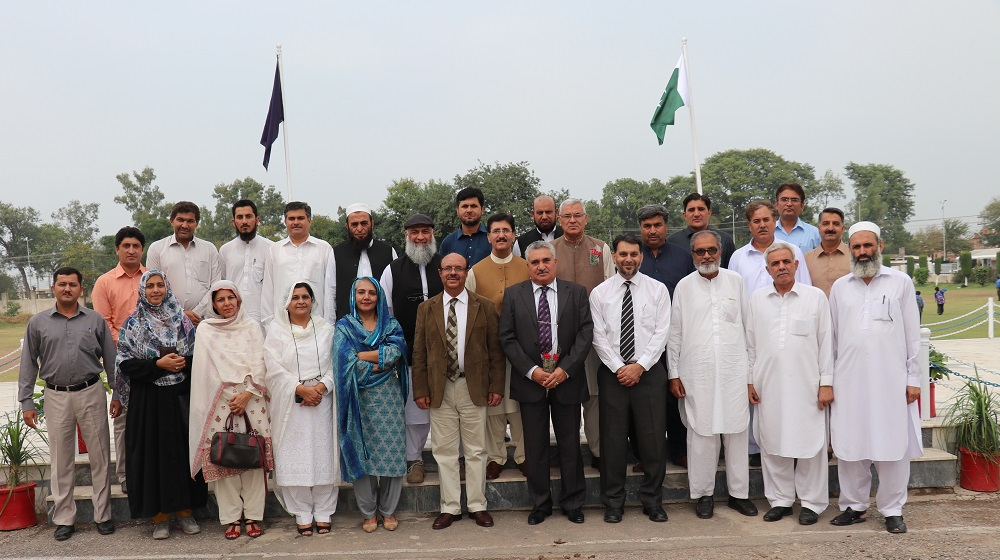 The Vice Chancellor University of Peshawar Prof. Dr. Muhammad Asif Khan is posing for a group photo with University Public School faculty and UPS alumni association key members on tuesday after a colourful function at main hall to appreciate BISE toppers from school.