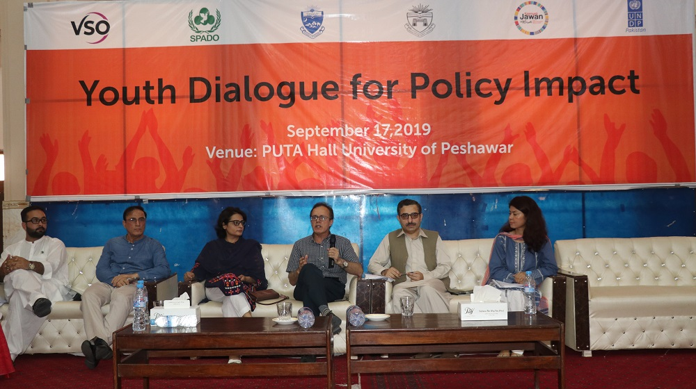 Speakers during a debate on 'Youth Dialogue and Policy impact' including RTI Commissioner Riaz Khan Daudzai, Chairman Journalism Dr. Faiz Ullah Jan and SPADO CEO Shah Raza Khan are reflecting their viewpoint on Youth policies at TCC hall, University of Peshawar on 17th September, 2019.
