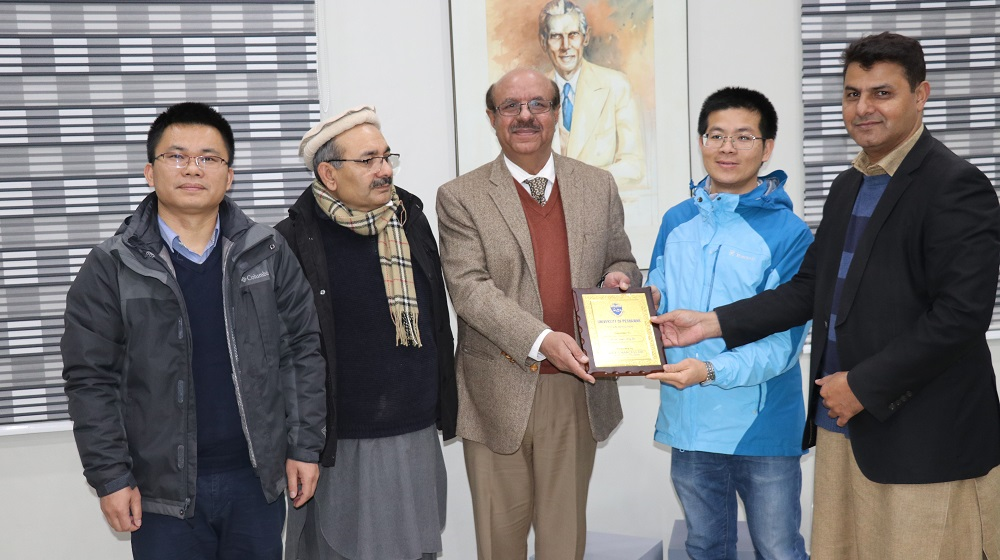 University of Peshawar's vice chancellor Prof.Dr.Muhammad Asif Khan is handing over shields to chinese university of Lanzhou, professors  for active collaboration in the field of atmospheric physics  with university of Peshawar on 7th January, 2020.