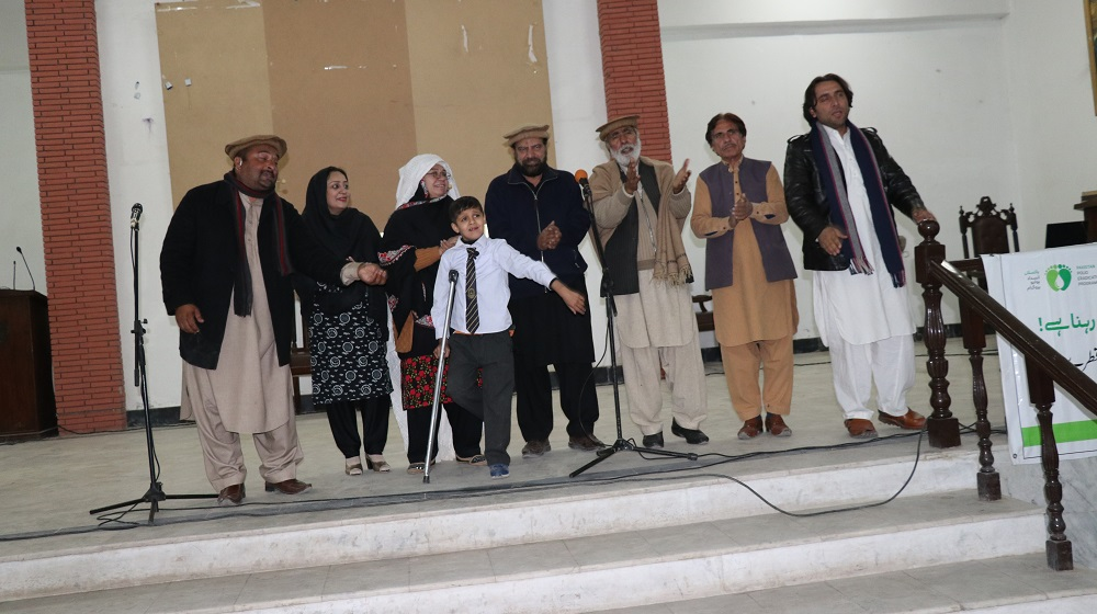 Actors at the end of the anti-polio stage show are waving to the applause of the students and faculty on 21st January, 2020 at Pashtun Cultural Museum Hall. The program was jointly organised by UNICEF, UoP and Emergency Operations Centre, KP Govt.