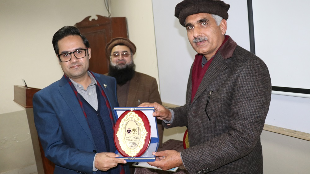 Pro-Vice Chancellor University of Peshawar Prof. Dr. Johar Ali  is handing over the shield to National Information technology Board E-Office deployment Faisal I. Ratyal for arranging Five day 'ToT'  for University administrative officers on 21 January, 2020.