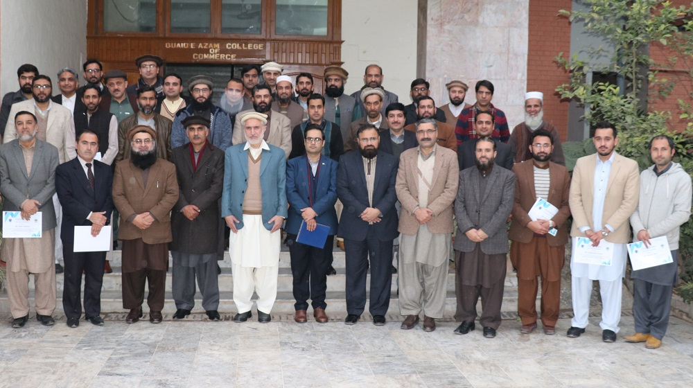 Pro-Vice Chancellor and Registrar , UoP are posing for a group photo with the trainers and participants of five day workshop on E-Office deployment at QACC premises on 21st Jan, 2020.