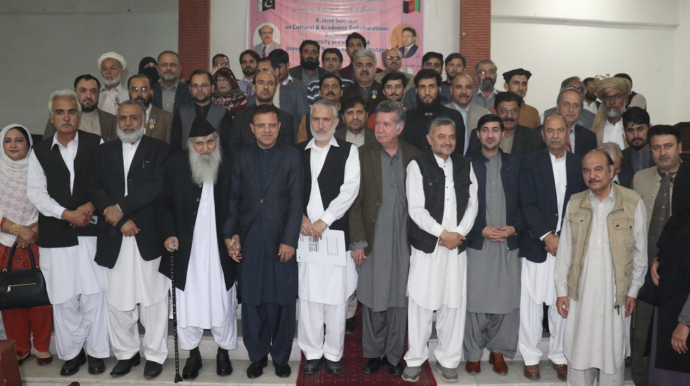 His Excellency, Afghan ambassador to Pakistan Dr. Omer Zakhiwal is posing for a photograph with 13 literati awardees of Afghan Presidential award along with faculty from both countries at Pashtun Musuem, University of Peshawar on 14th November, 2018.
