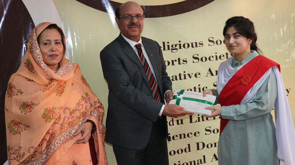 The Vice Chancellor University of Peshawar is handing over the certificates to the president students societies Poona sardar at the installation ceremony at the college of Home Economics on 15th November, 2018.